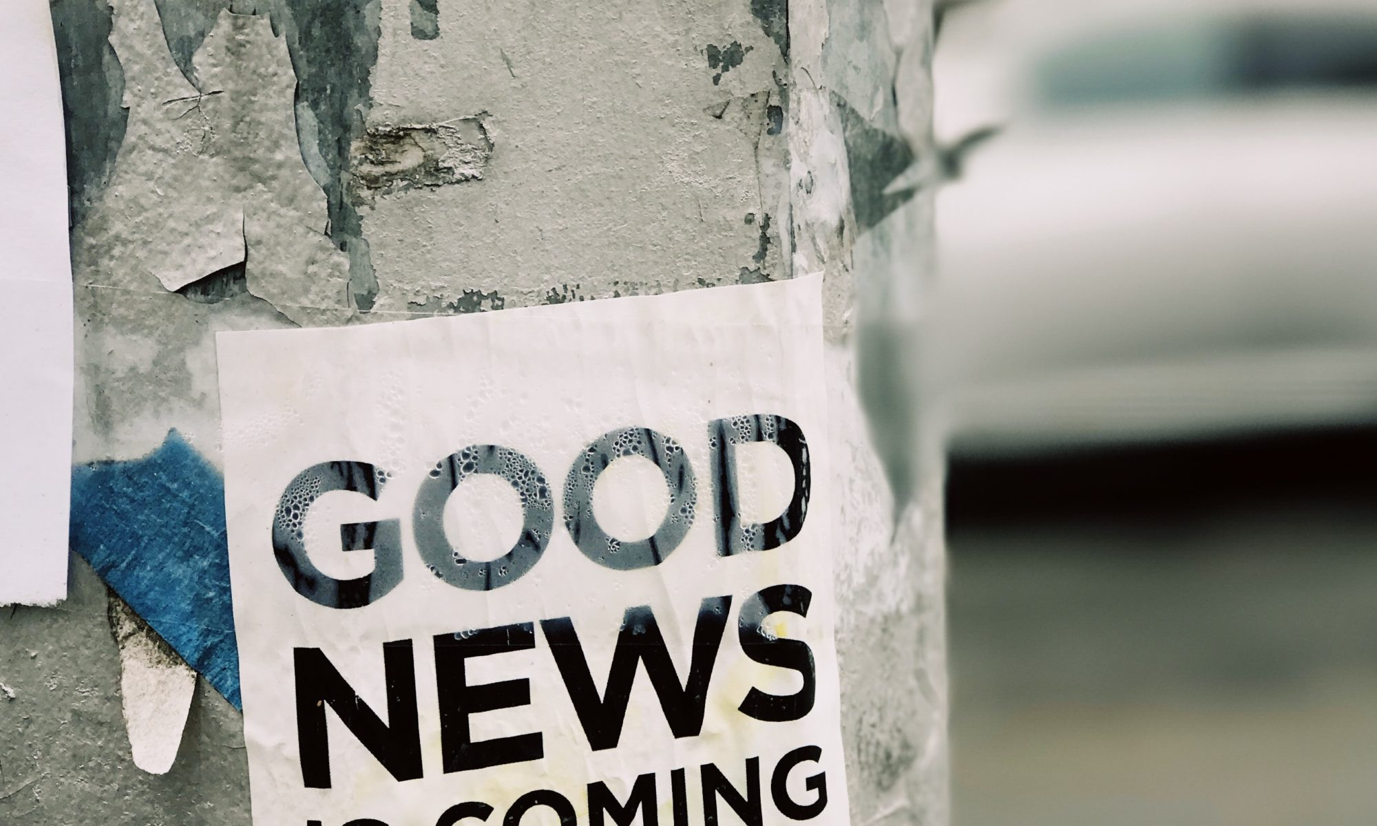 white Good News Is Coming paper on wall - communication
